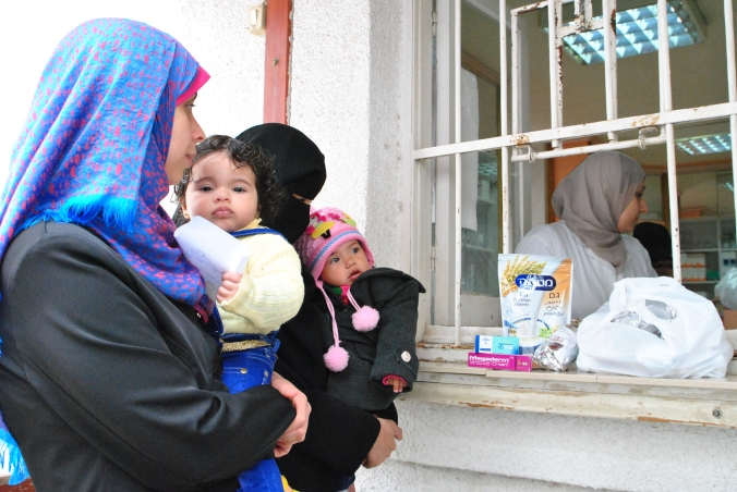 Family at Al Ahli hospital collecting food for their malnourished child